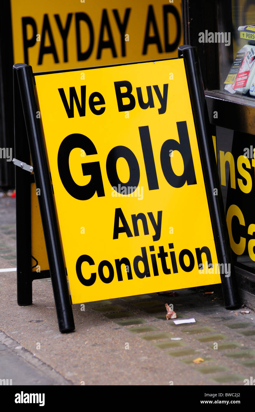 We Buy Gold Any Condition sign outside a Pawnbrokers Shop, Shepherds Bush, London, England, UK - Stock Image