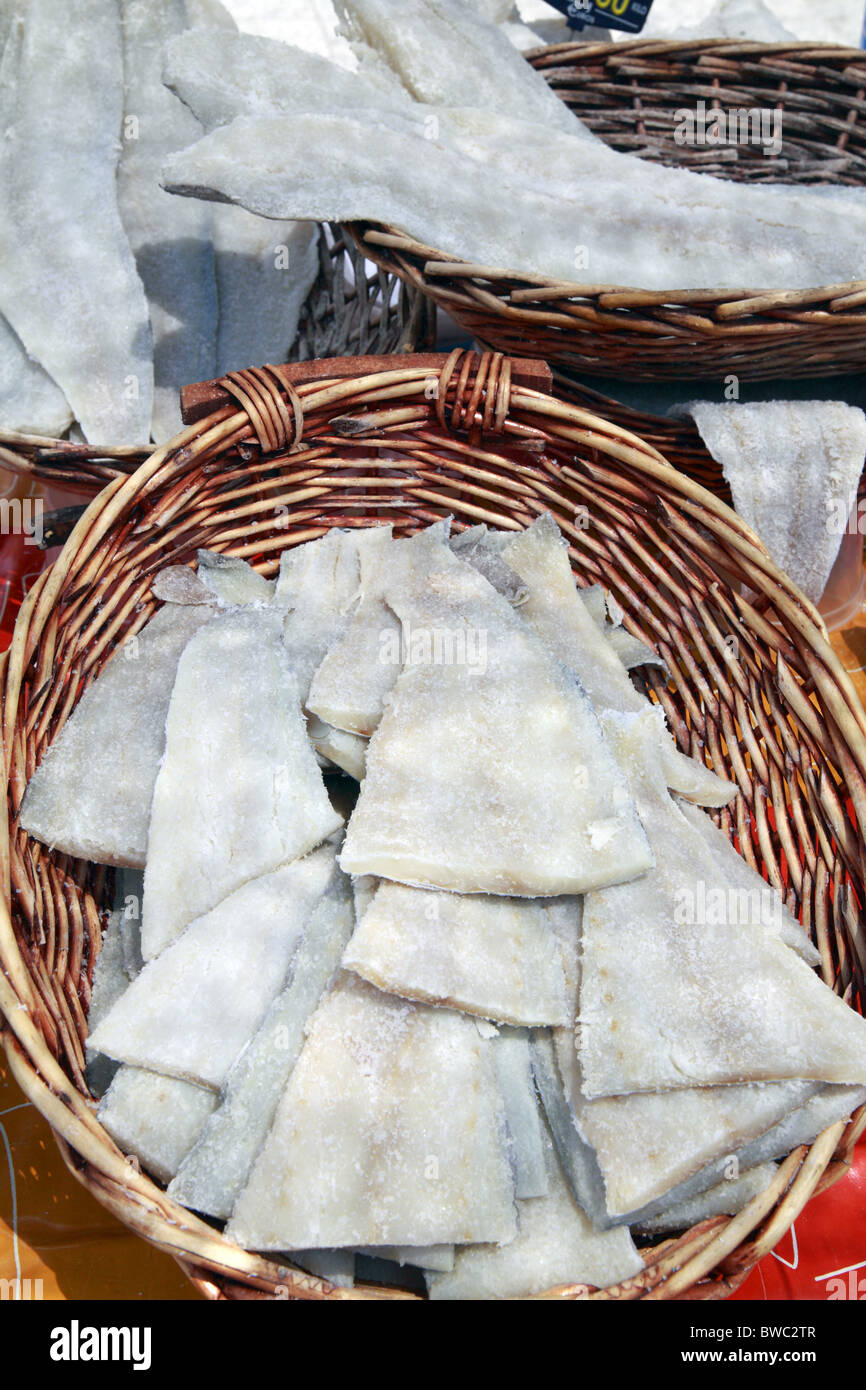 Vending traditional salt cod-fish on a market in Vic, Spain - Stock Image