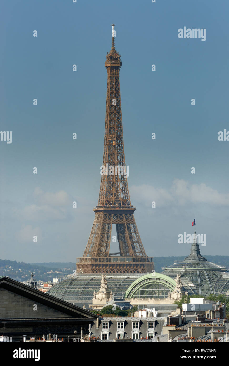 Famous world landmark Eiffel Tower as viewed from a rooftop in the 9th Arrondissement of Paris, France. - Stock Image
