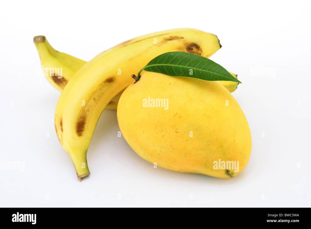 Mango and bananas on white - Stock Image