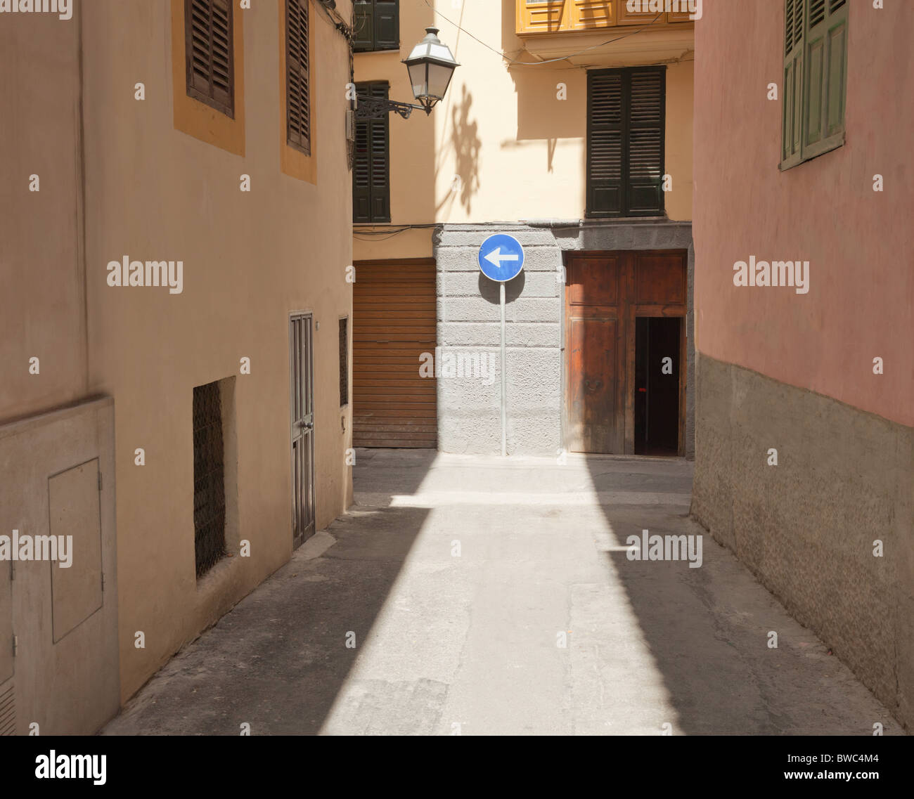 Street with direction sign - Stock Image