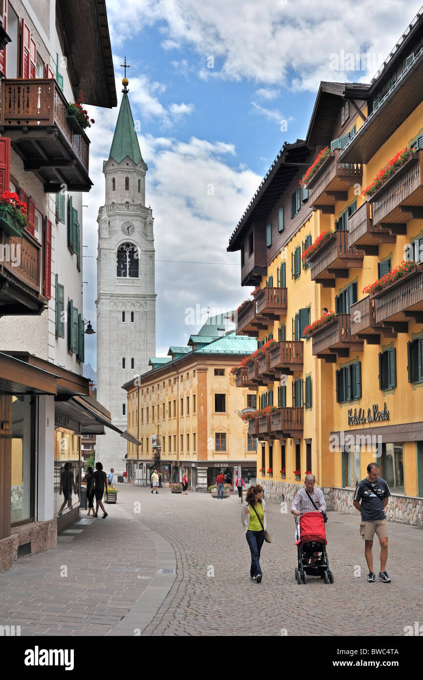 Shopping street and the parish church at Cortina d'Ampezzo, Dolomites, Italy - Stock Image