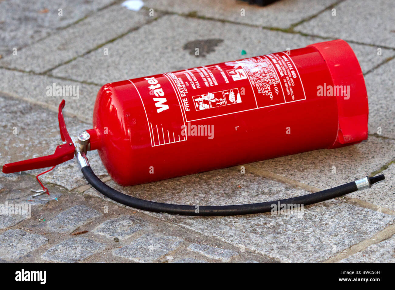 Fire extinguisher thrown from roof during student protests against tuition fees Stock Photo