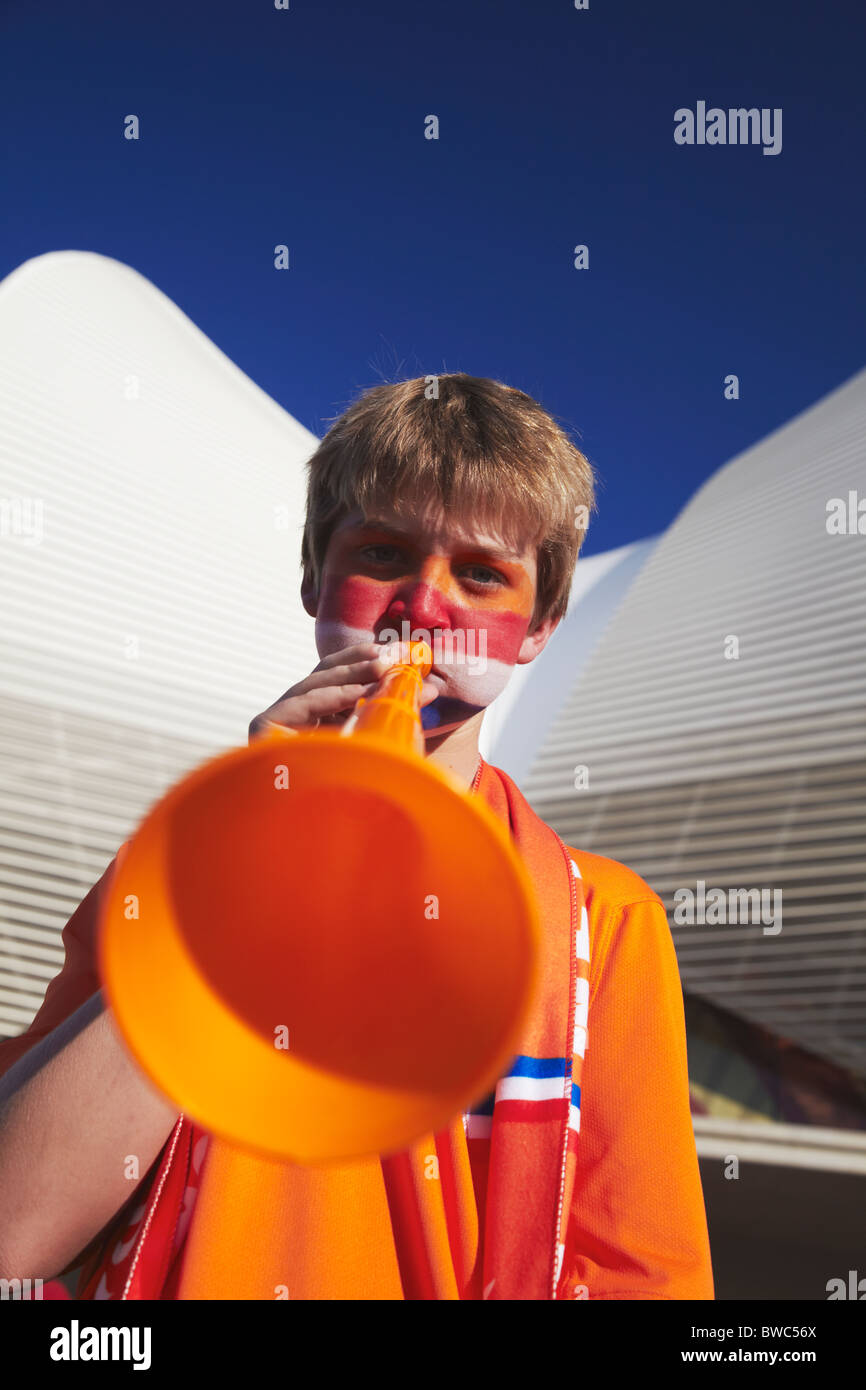 Dutch football fan blowing vuvuzela at World Cup match, Port Elizabeth, Eastern Cape, South Africa - Stock Image