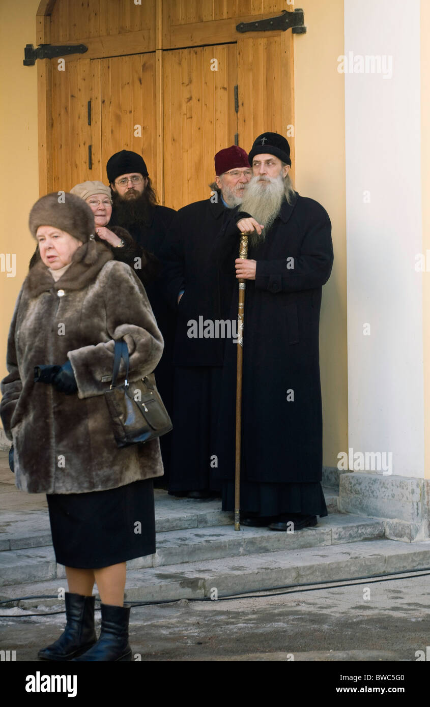 Orthodox priests and Russian old women gathering at Pushkin Memorial Flat on the Centenary of his death - 'St - Stock Image