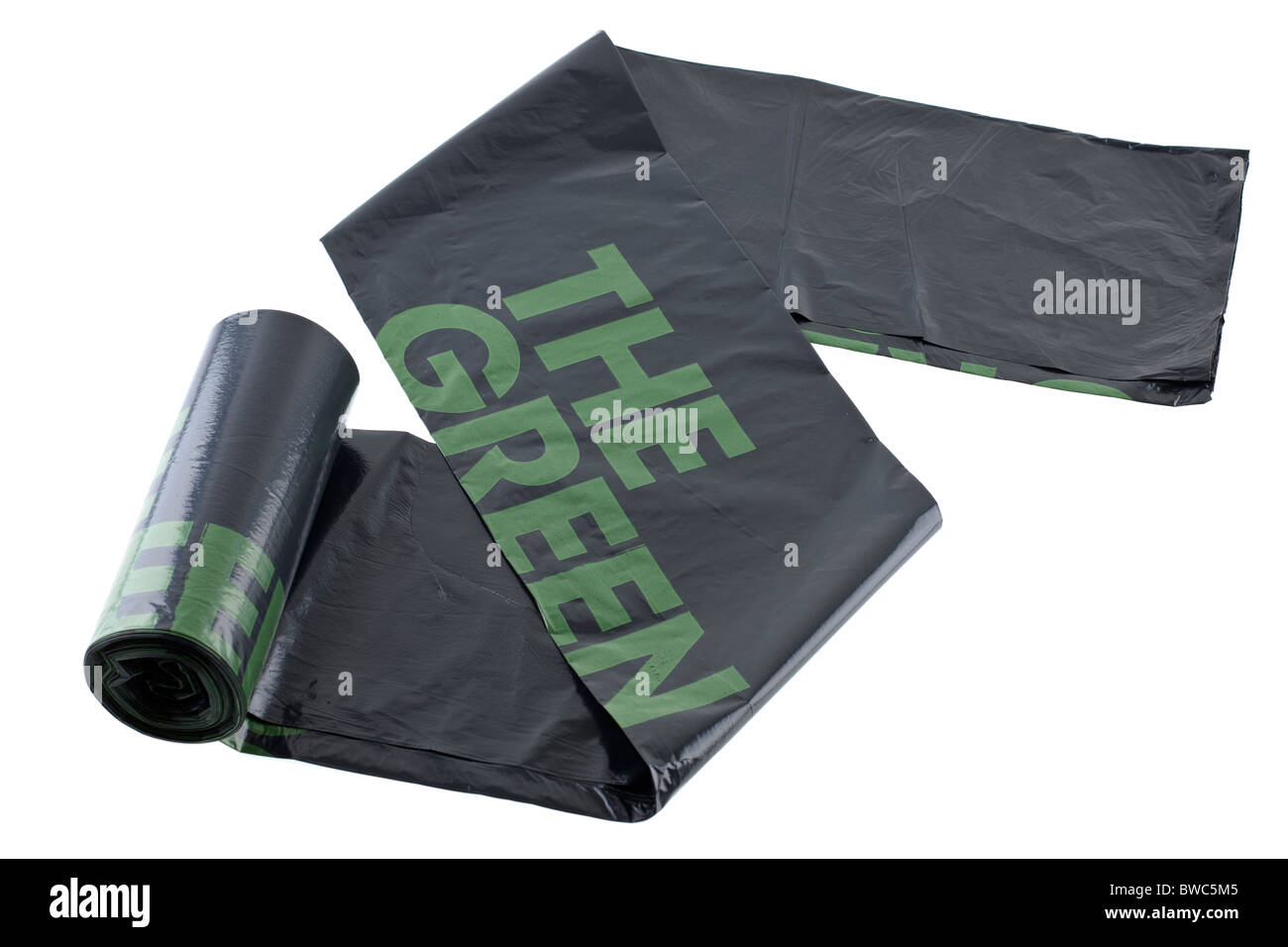 Roll of black and green refuse sacks - Stock Image
