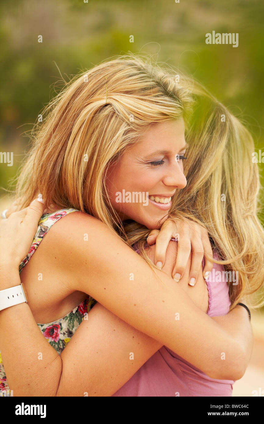 Mother and grown-up daughter embracing - Stock Image
