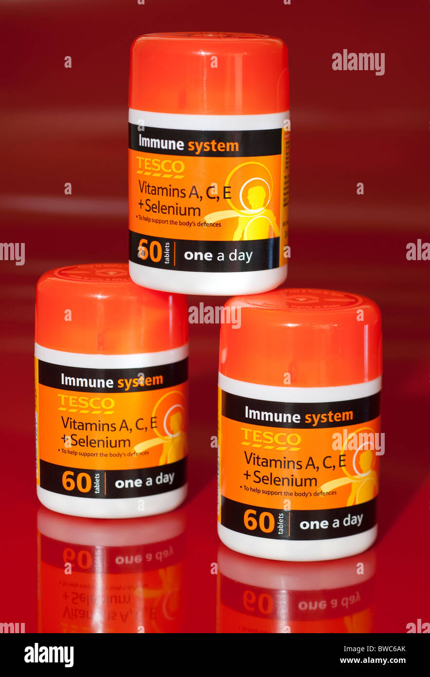 Three 60 tablet tubs of Tesco one a day vitamins A C E and Selenium - Stock Image