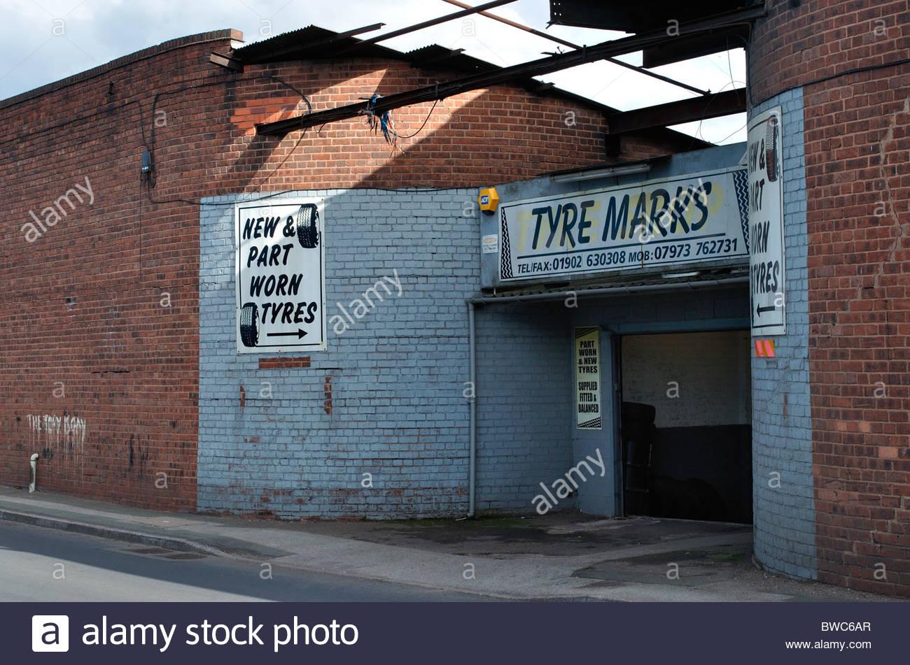 Tyre warehouse selling part worn tyres, Wolverhampton, West Midlands - Stock Image
