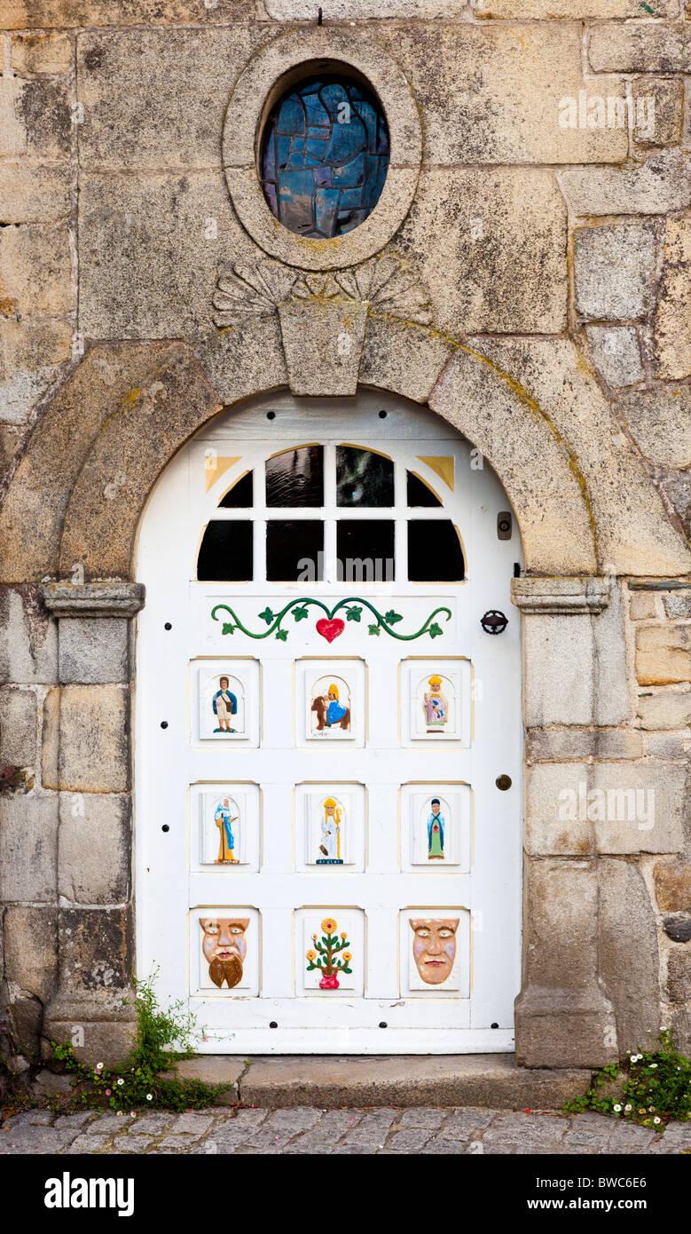 Painted wooden door in Rochefort en Terre, Morbihan, Brittany France Europe - Stock Image