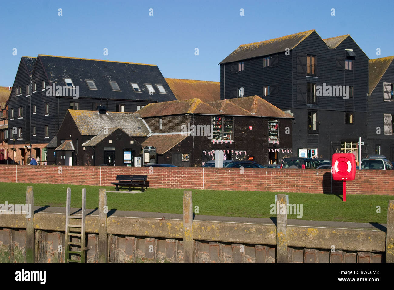 public access riverside lawn and seating Georgian warehouses - Stock Image