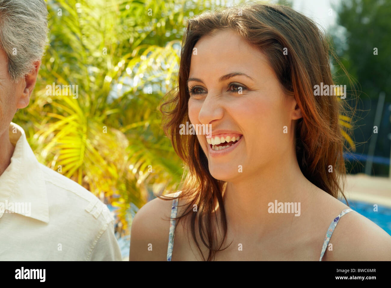 Portrait of beautiful woman laughing - Stock Image