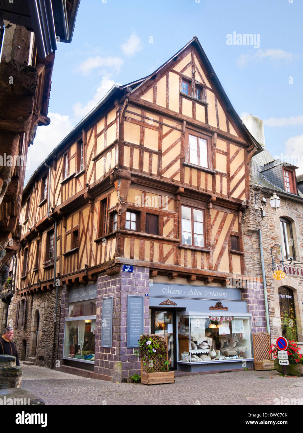 Brittany - Half timbered medieval French house and shop at Malestroit, Morbihan, Brittany, France, Europe - Stock Image
