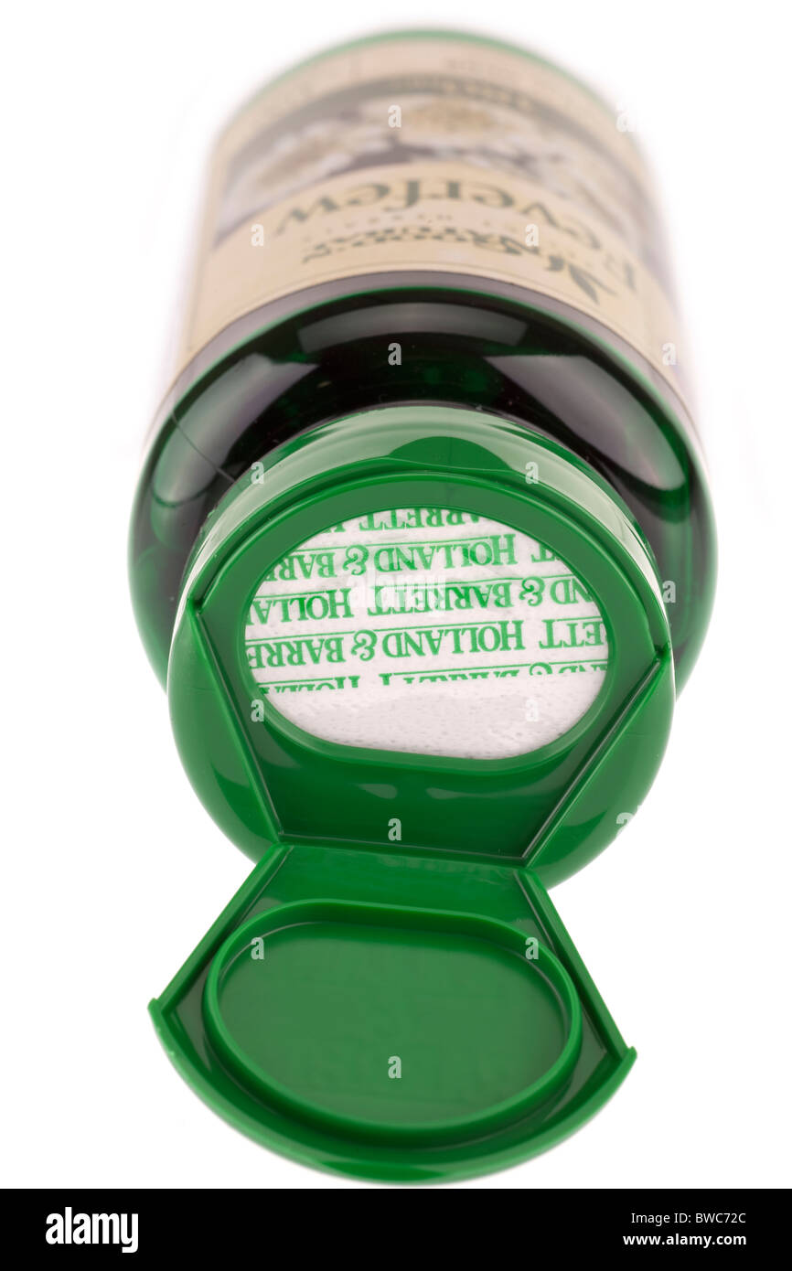 Inner paper seal on a green flip top container - Stock Image