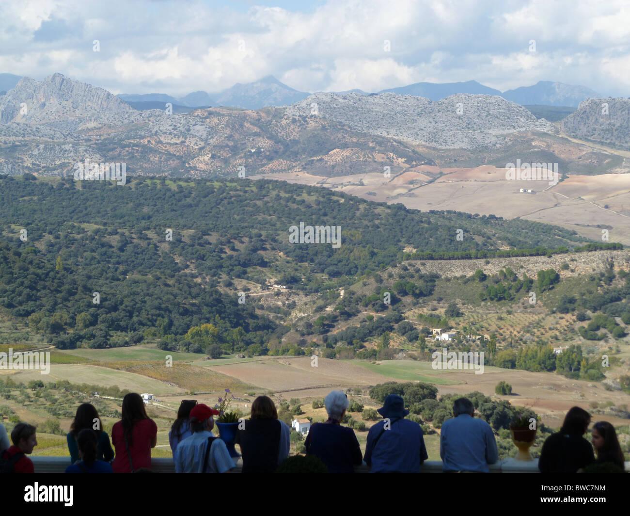Visitors enjoying the view of the Serrania de Ronda from Casa Don Bosco in Ronda, Andalucia - Stock Image