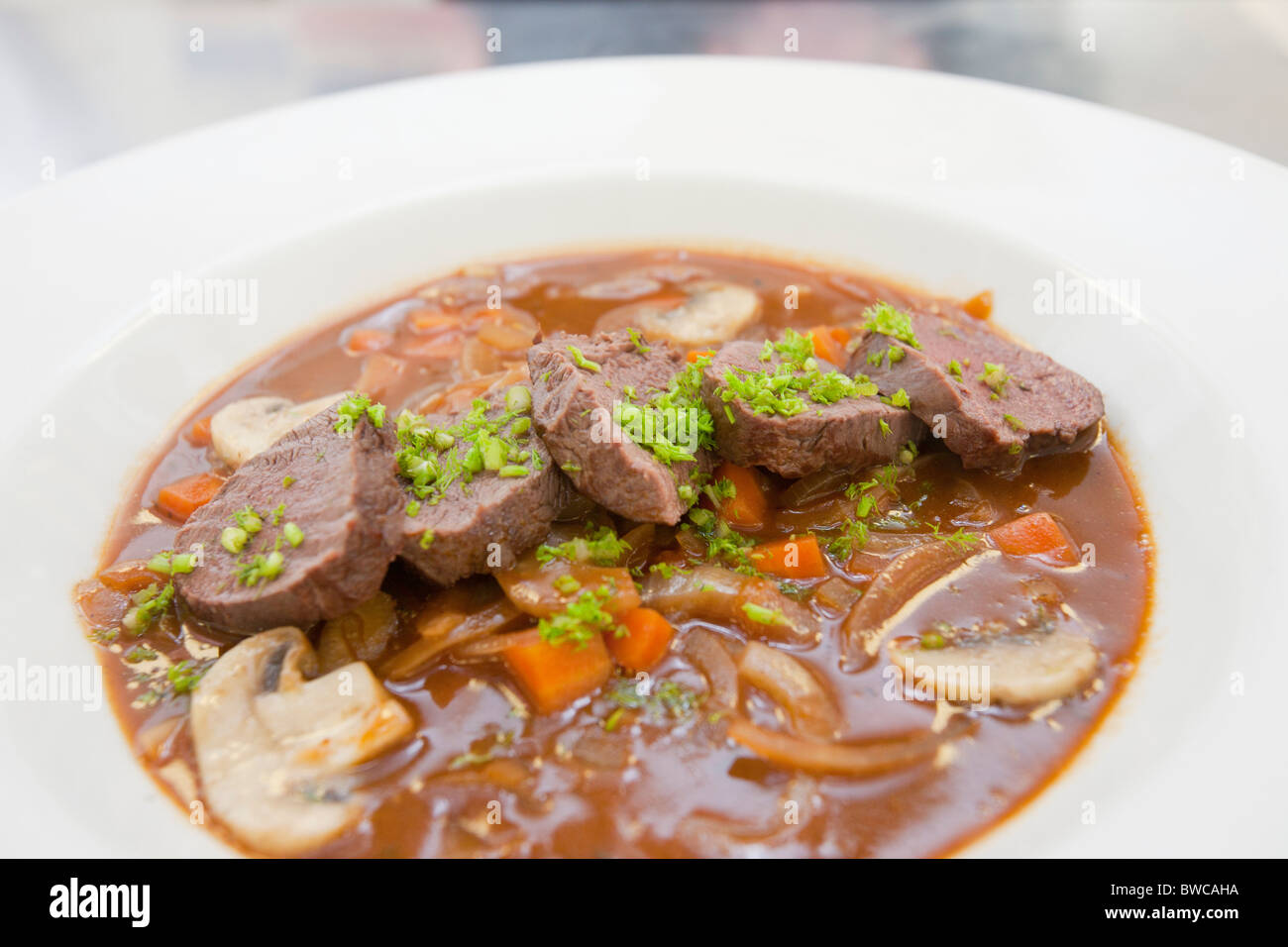 A dish prepared by catering students from Kendal College, Cumbria, UK, using wild venison - Stock Image