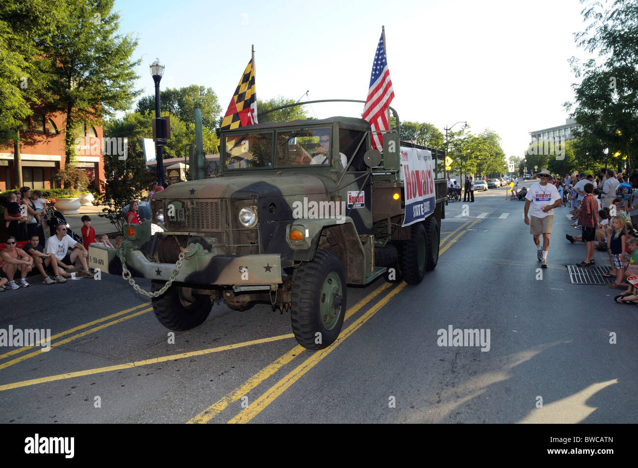 a military truck is used to advertise a politician in a July4 parade in Annapolis,Md - Stock Image