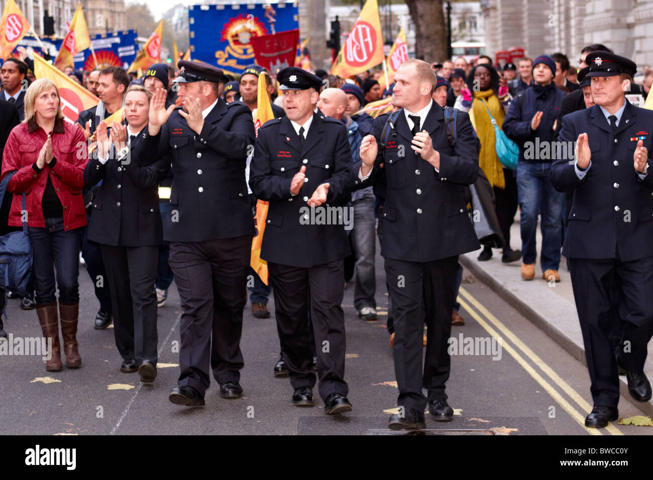 Firefighters march during an industrial dispute - Stock Image