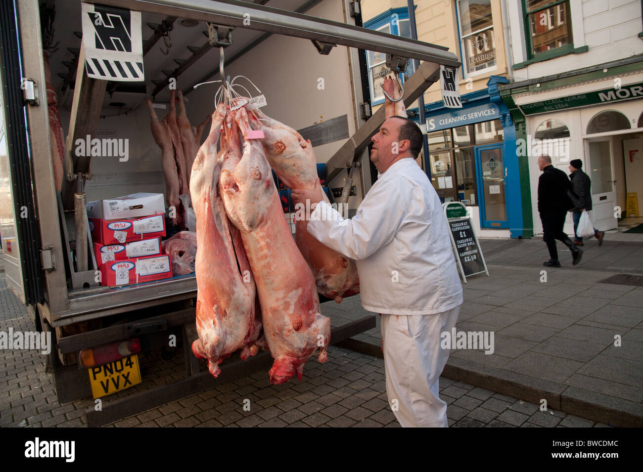 Fresh meat being delivered to a small family butcher, Aberystwyth Wales UK - Stock Image