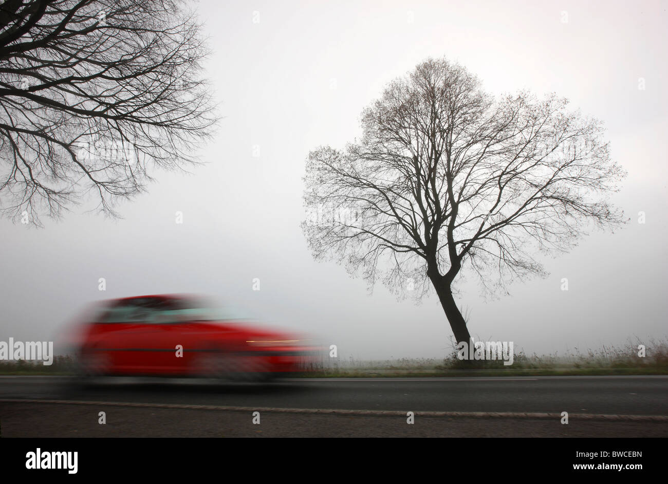 Autumn, thick fog, low visibility on a road. Essen, Germany. - Stock Image