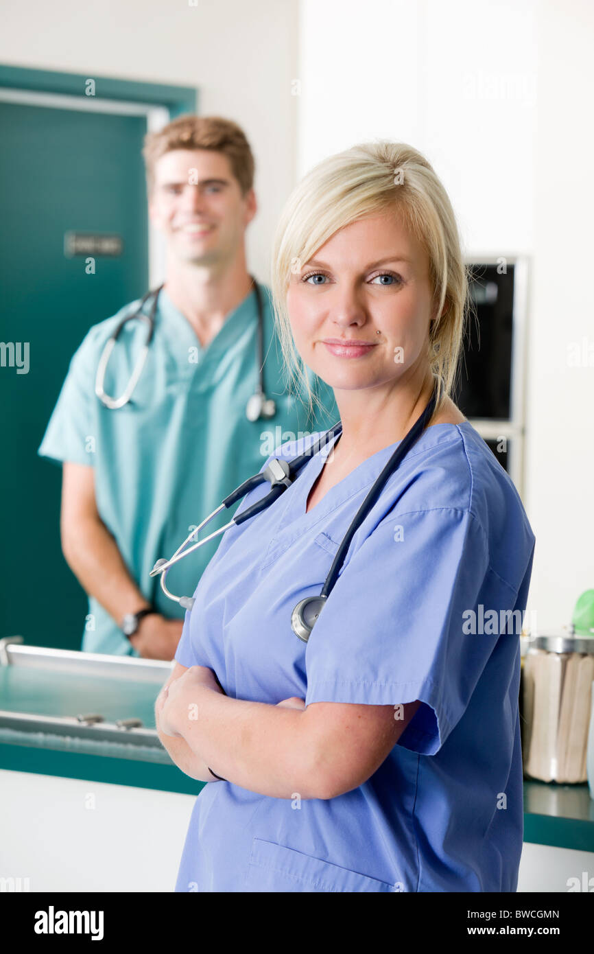 A portrait of a vet and assistant in a small animal clinic - Stock Image