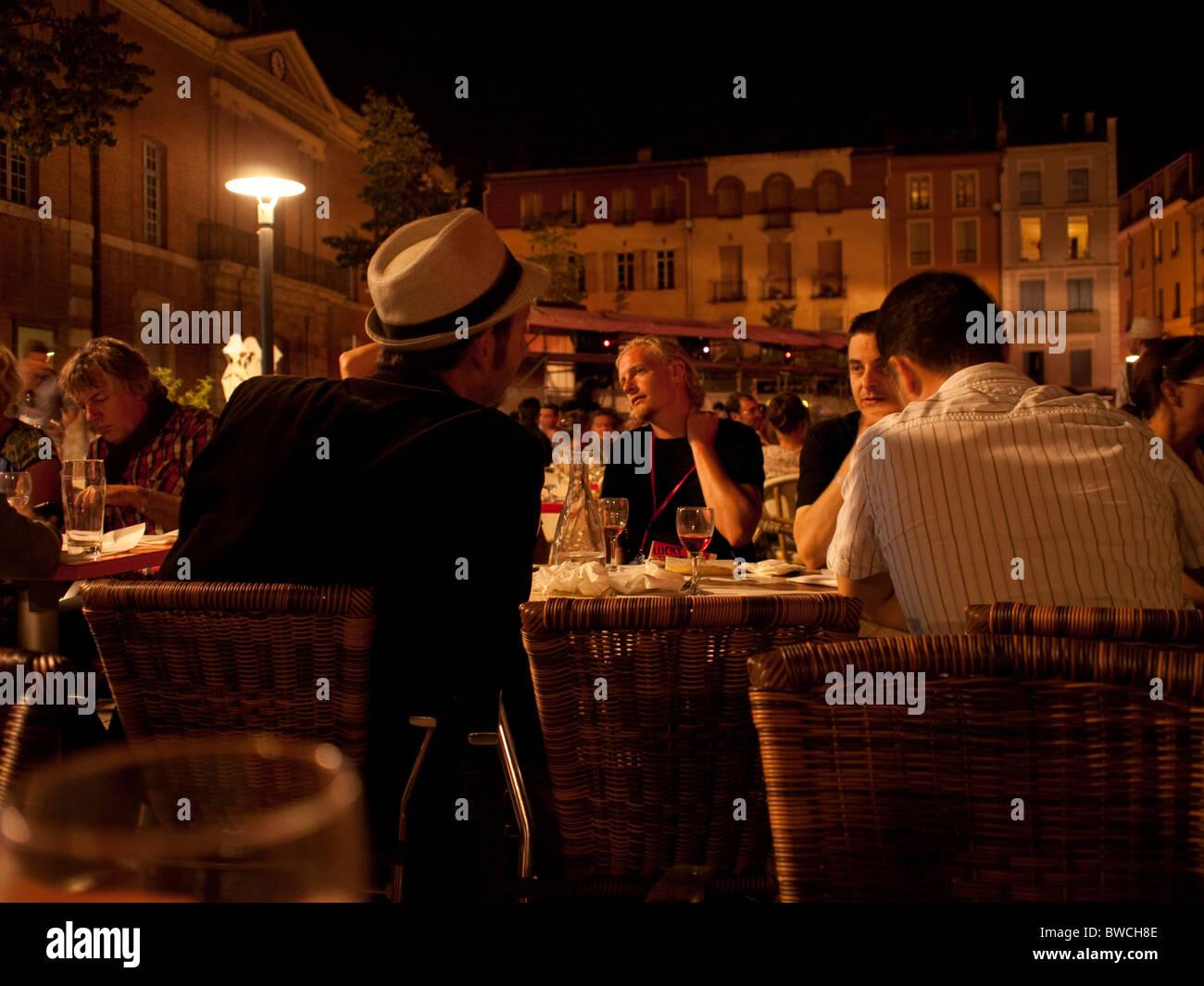 Outdoor restaurant in Place de la République Perpignan France during the evening picture show during festival - Stock Image