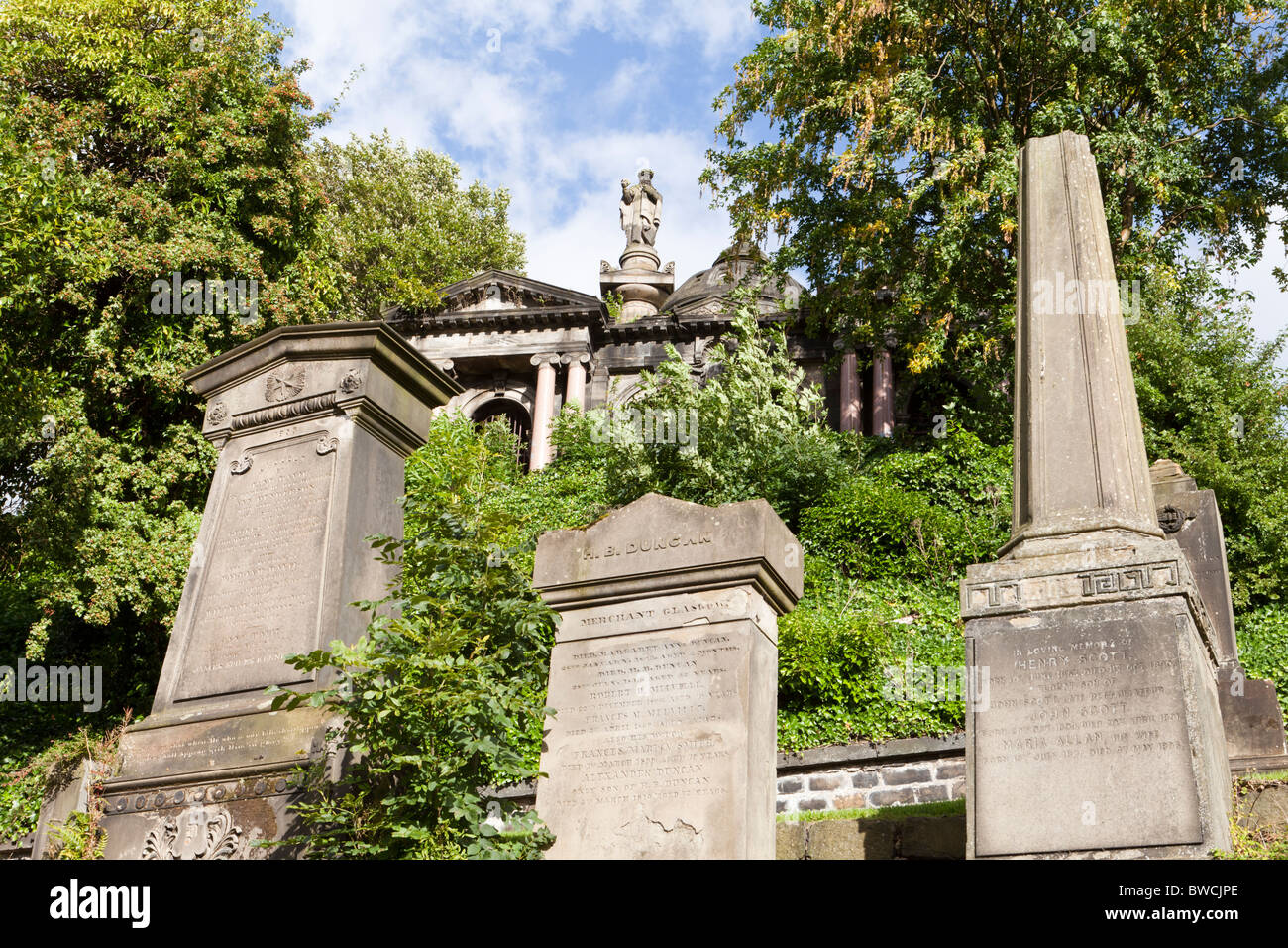 Memorials in the Glasgow Necropolis which lies to the east of Glasgow Cathedral, Scotland - Stock Image