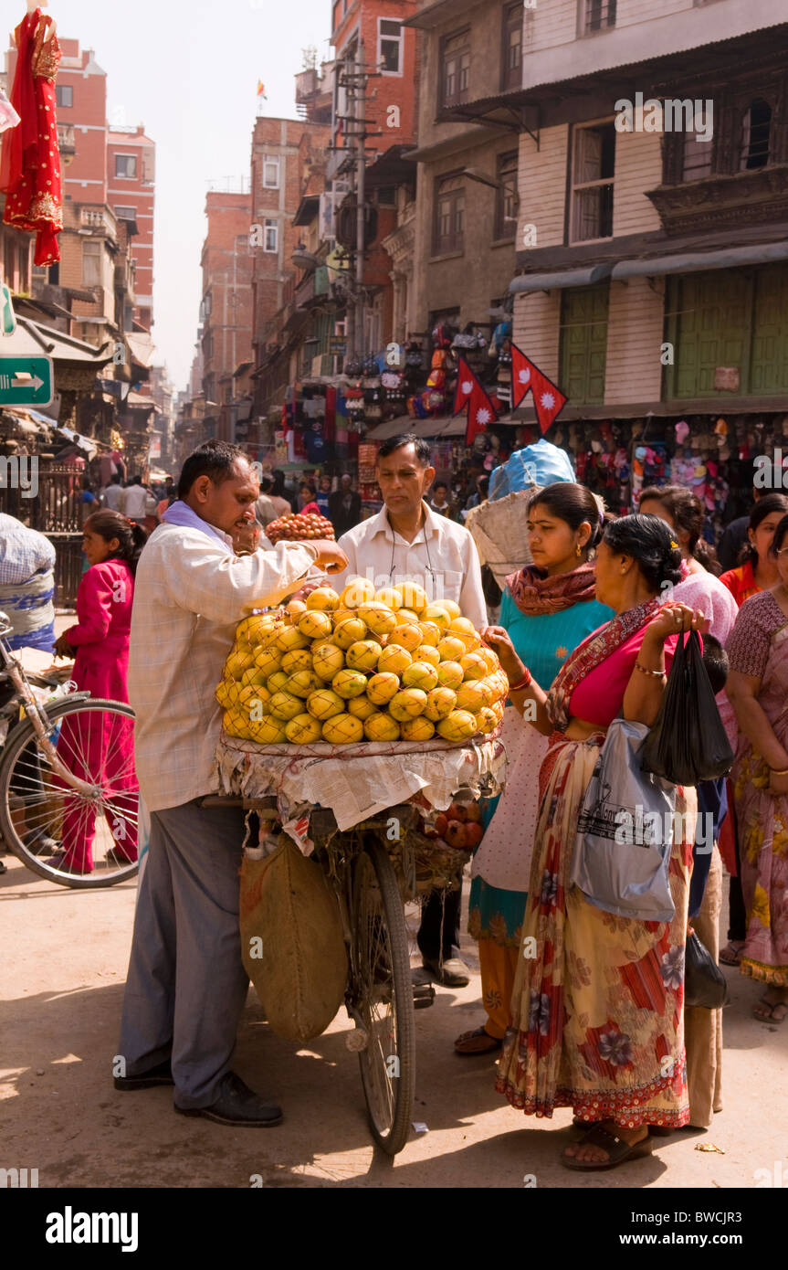 Street seller and buyers in Kathamandu, Nepal - Stock Image