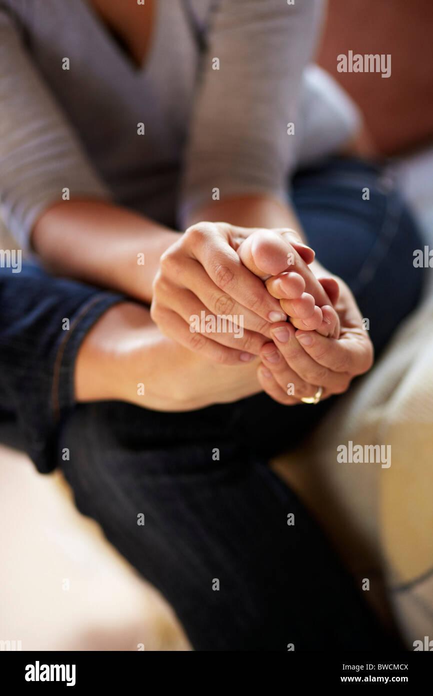 Woman massaging foot - Stock Image