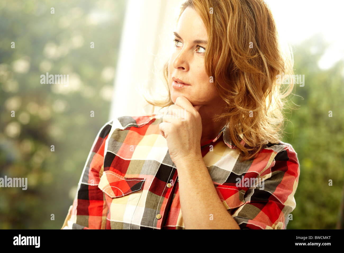 Concerned looking woman Stock Photo