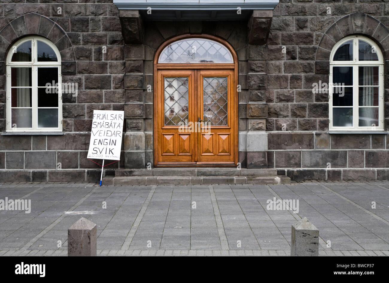 Reykjavik - Iceland, June 9, 2009: A demonstrators sign outside the Icelandic Parliament, Althingi. - Stock Image