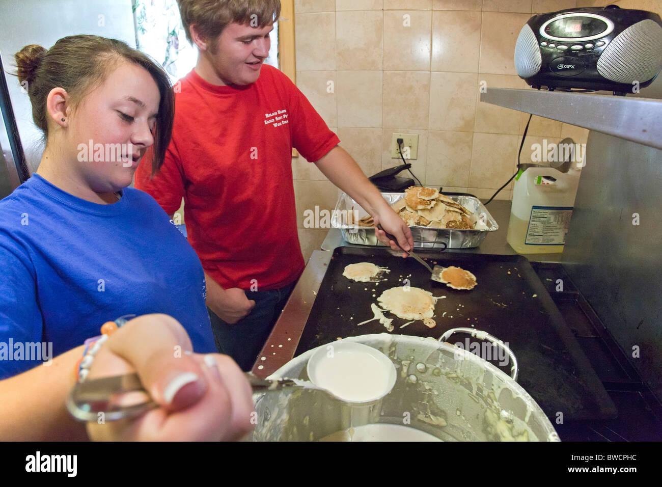 Cooking Pancakes Teen Stock Photos & Cooking Pancakes Teen ...