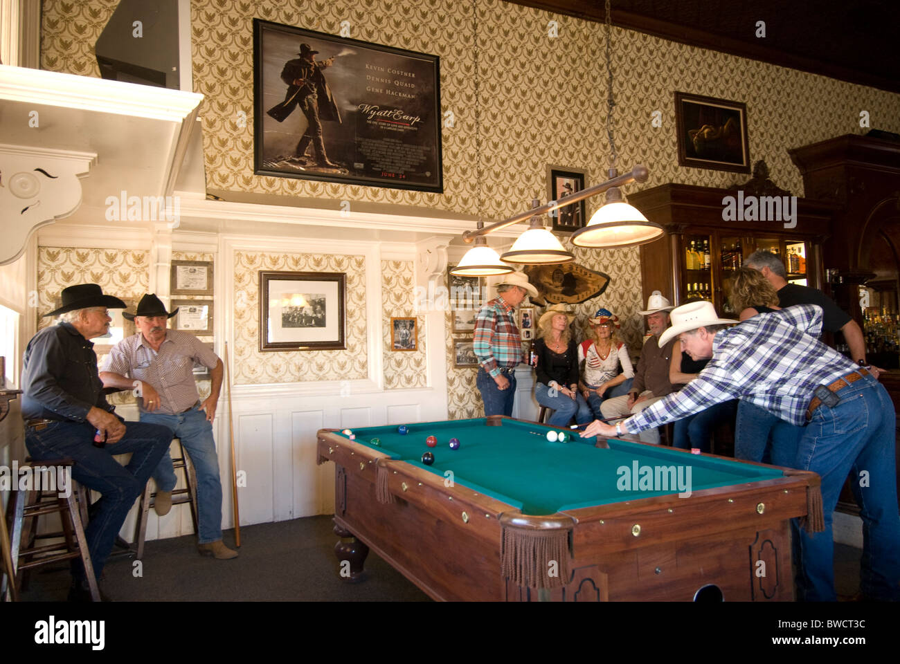 Shooting pool at the Crystal Palace Saloon in old mining town of Tombstone, a national historic landmark district - Stock Image