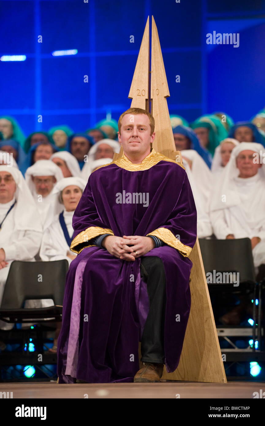Chaired Bard Tudur Hallam on stage during a ceremony at the National Eisteddfod of Wales annual Welsh cultural festival - Stock Image