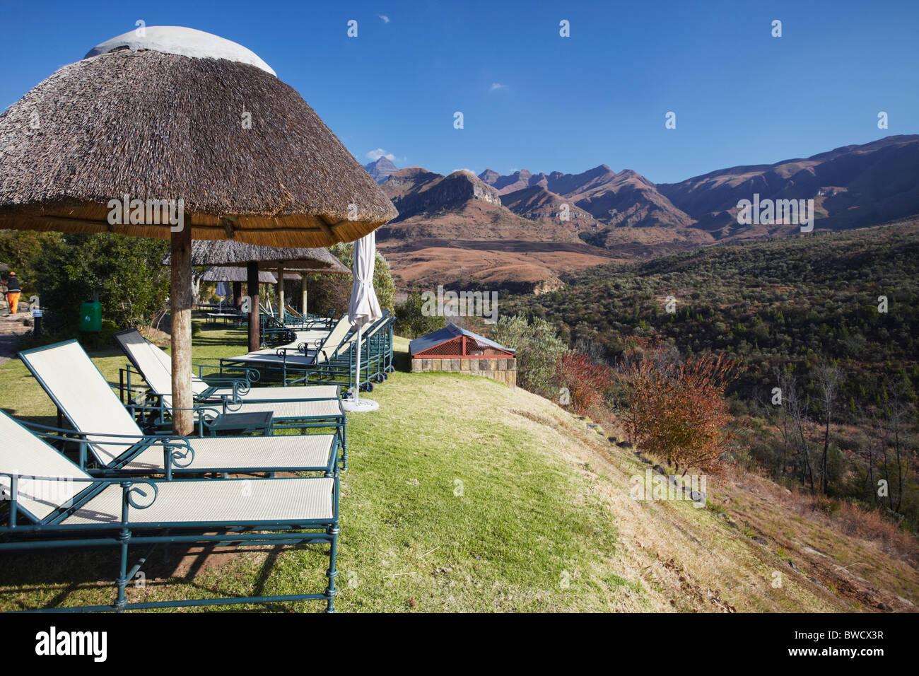 Sun loungers at Cathedral Peak Hotel, Cathedral Peak Nature Reserve, Ukhahlamba-Drakensberg Park, KwaZulu-Natal, - Stock Image