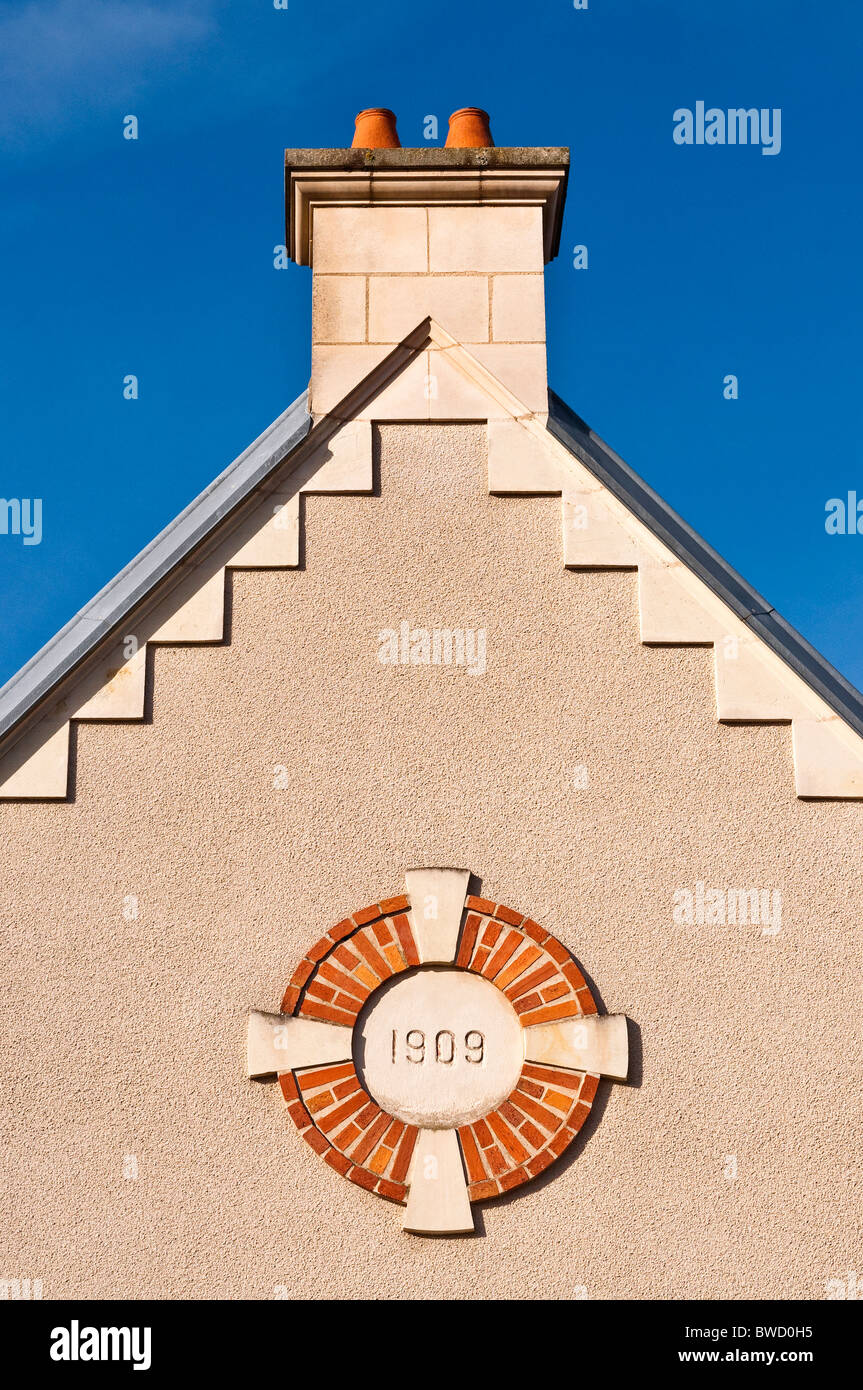 100 year old building date plaque on gable-end of house - France. - Stock Image