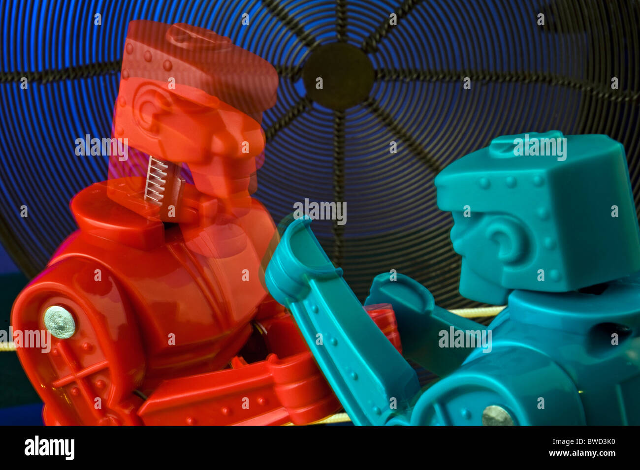 "red and blue, concept, conceptual,An artistic view of  ""Rock 'em Sock 'em Robots"" a classic game from the 1970's Stock Photo"