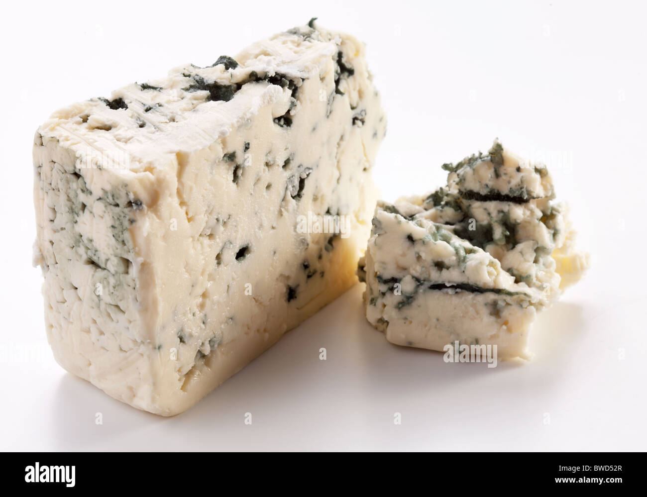 Pieces of blue cheese on a white background. - Stock Image