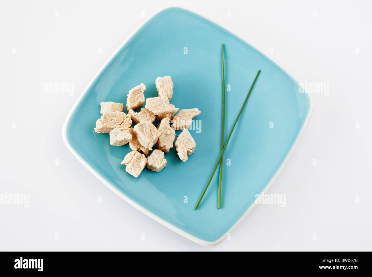 Fresh raw Quorn on blue plate - Stock Image