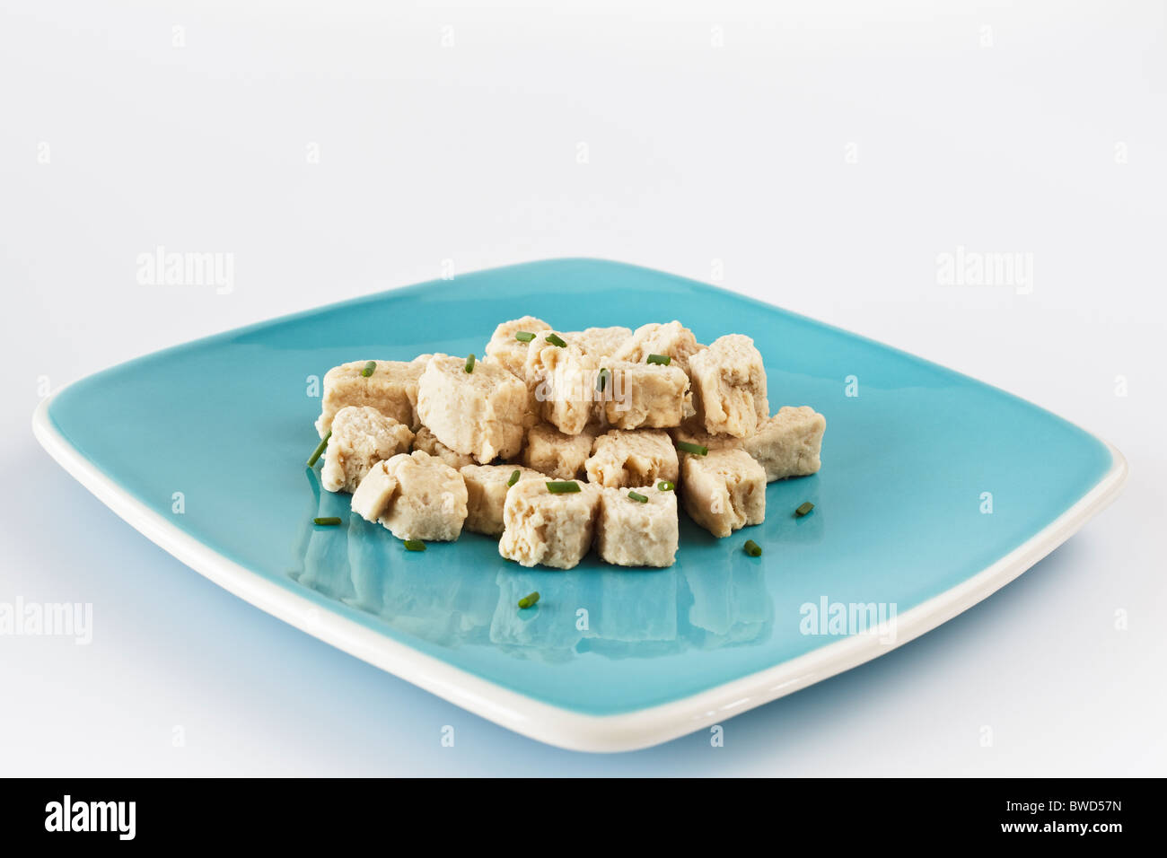 Fresh Quorn on blue plate - Stock Image