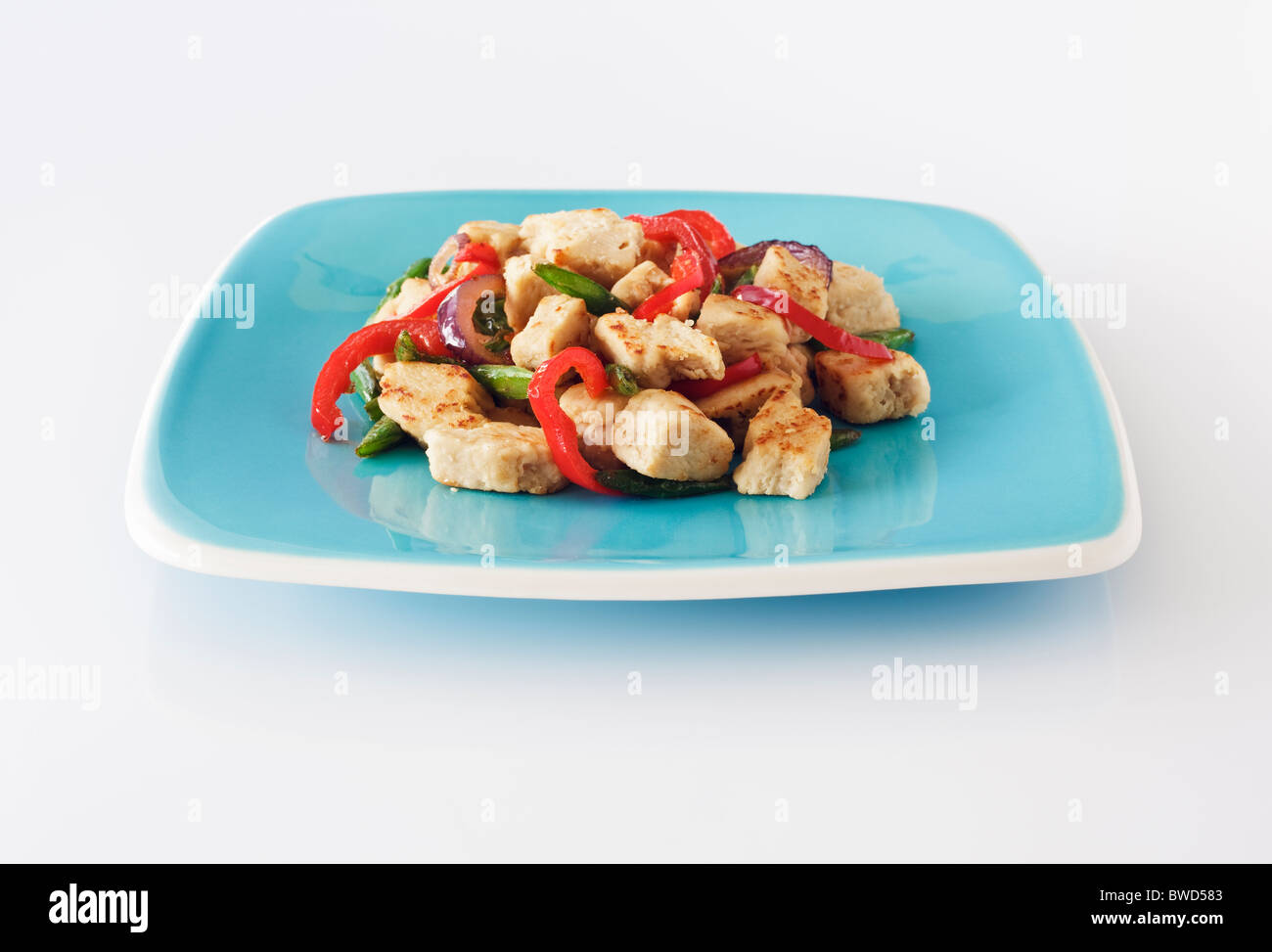 Quorn stir-fry on square blue plate - Stock Image