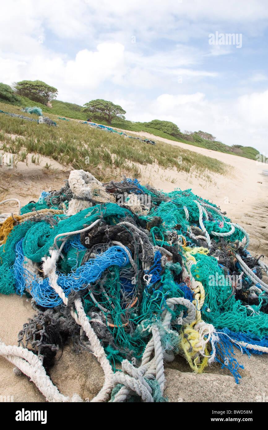 Fishing net debris washed up on Kahuku beach - Stock Image