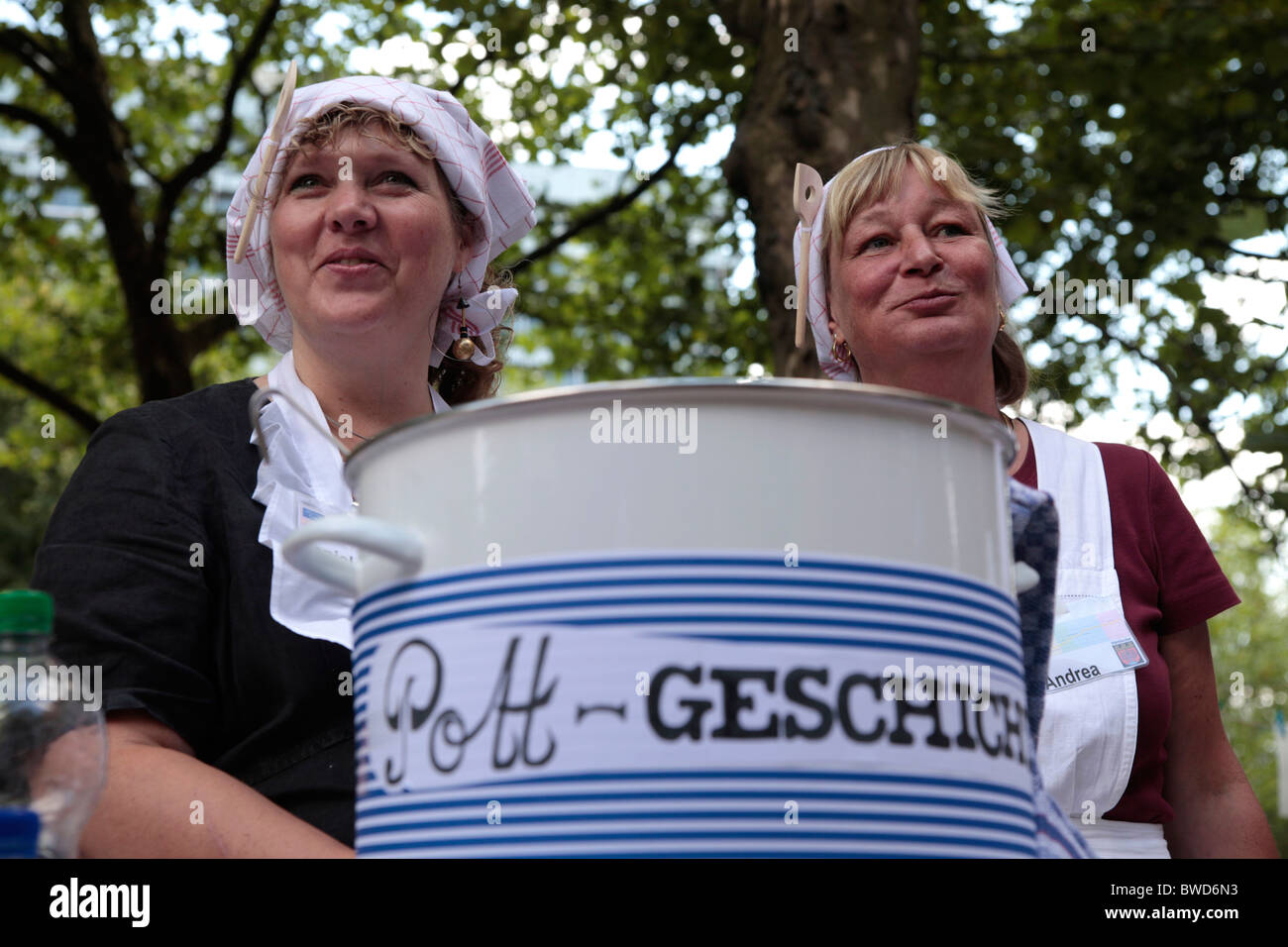 woman cooking on the german highway A40 in dortmund, ruhr area - Stilleben event in Summer 2010 - Stock Image