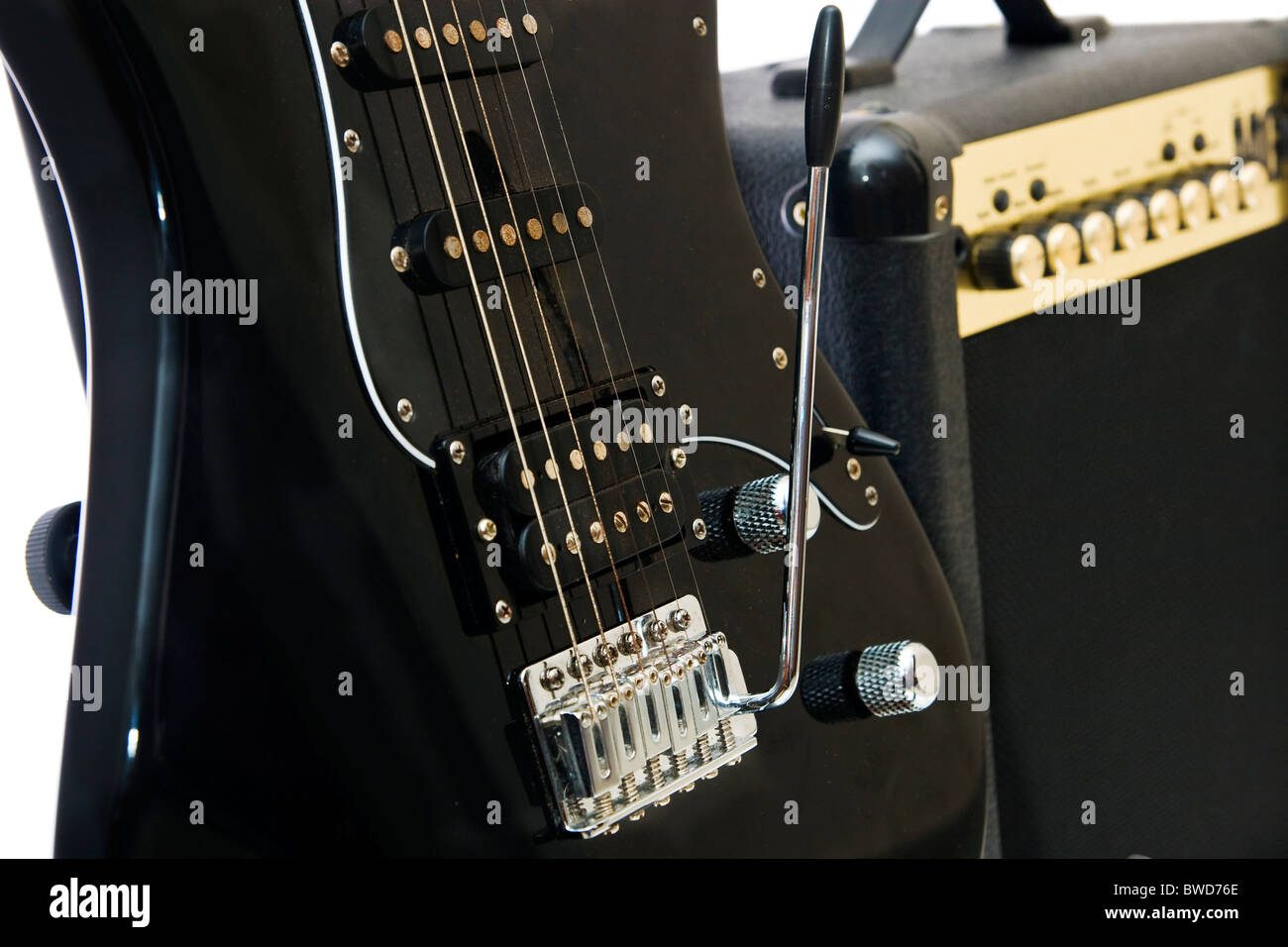 Electric guitar and amplifier isolated on a white background Stock Photo