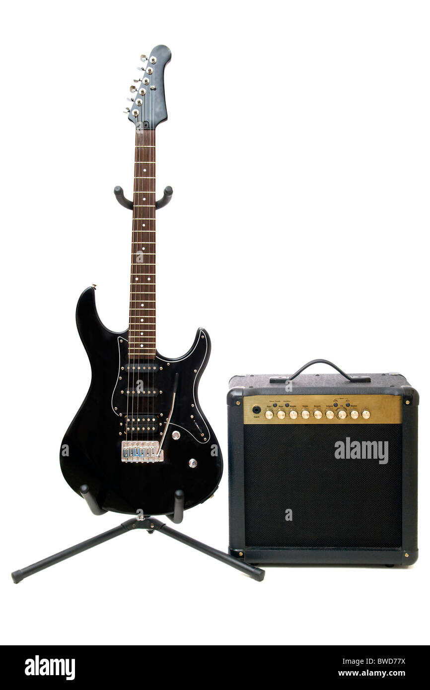 Electric guitar and amplifier isolated on a white background - Stock Image