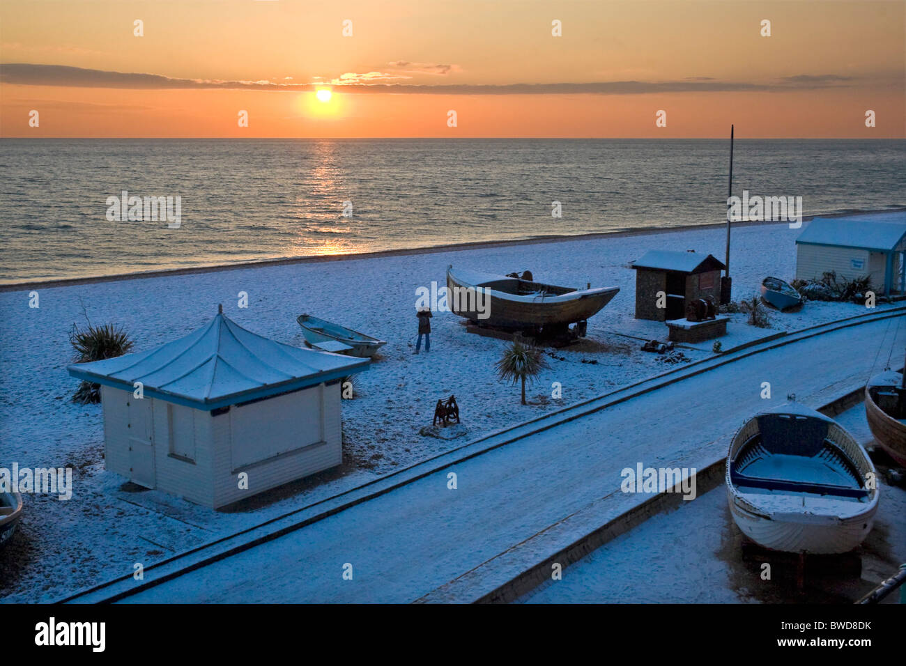 Boats on snow covered beach at sunset. Brighton, UK JPH0269 Stock Photo