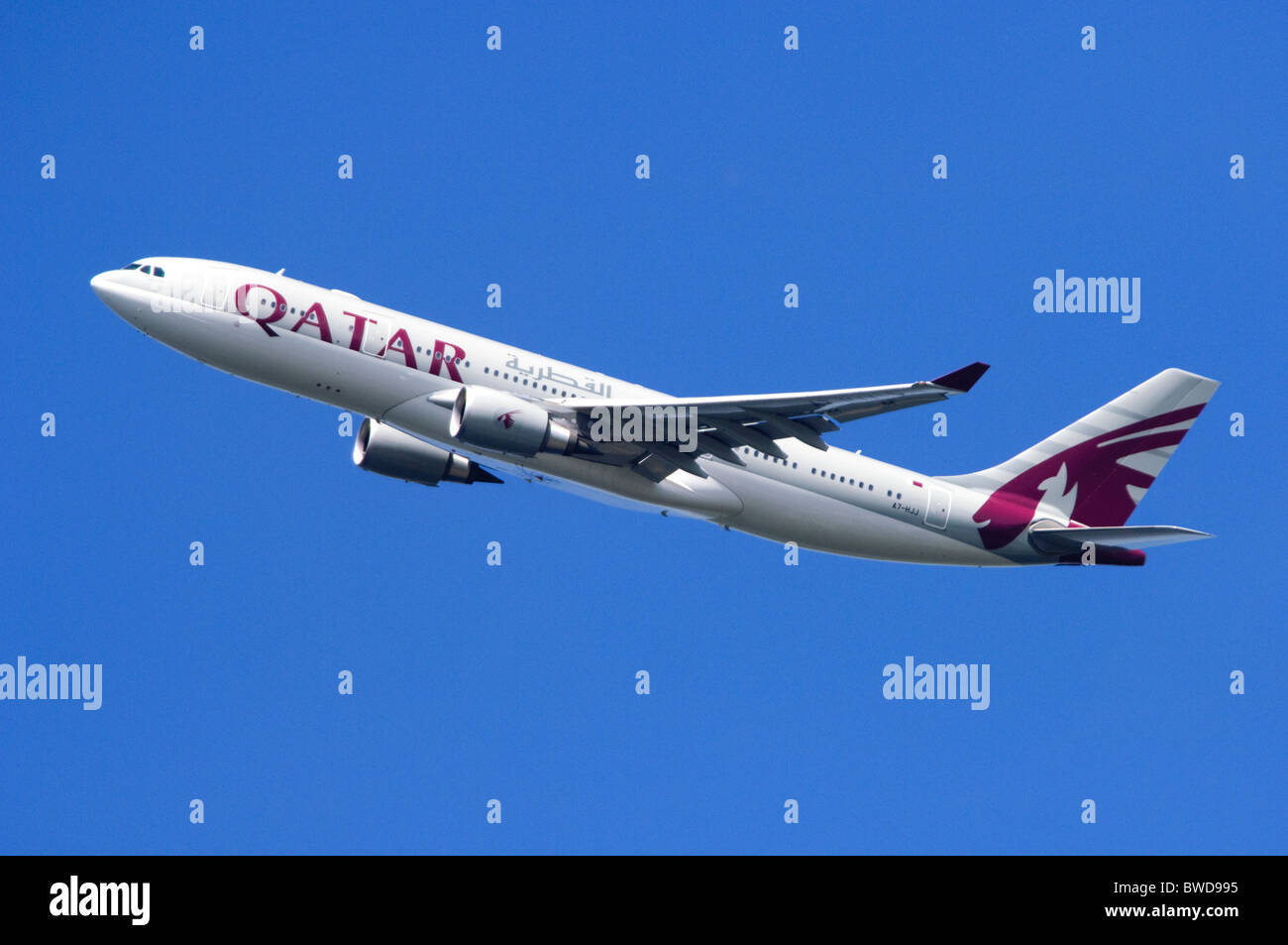 Airbus A330 operated by Qatar Airways climbing out after take off from London Heathrow Airport - Stock Image