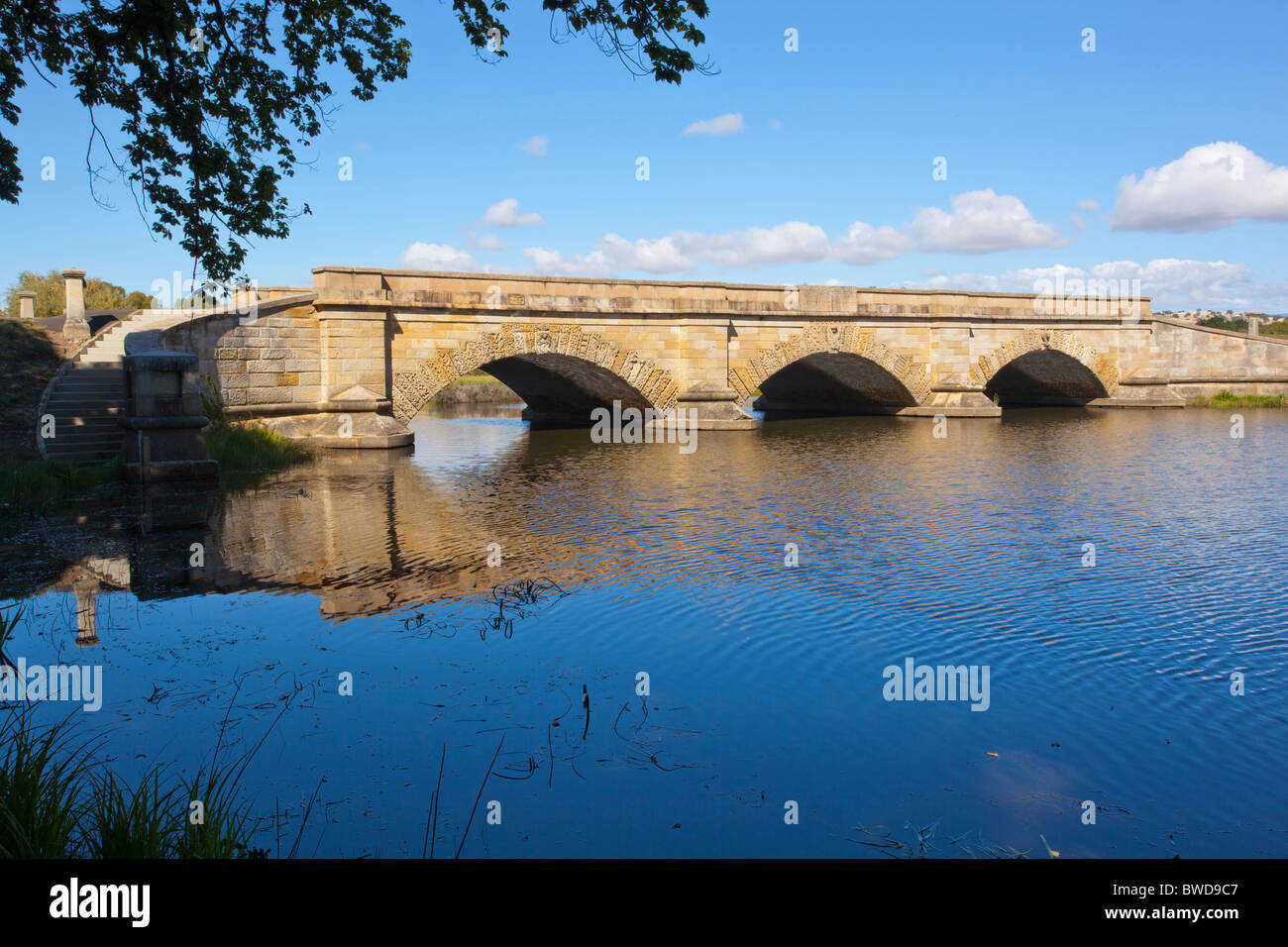 Old convict built bridge in the historic town of Ross in Tasmania - Stock Image