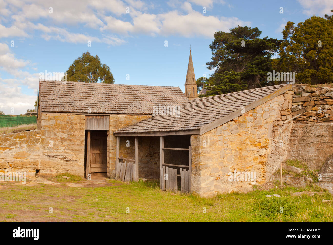 The old convict built stables in the historic town of Ross stand near the village church - Stock Image