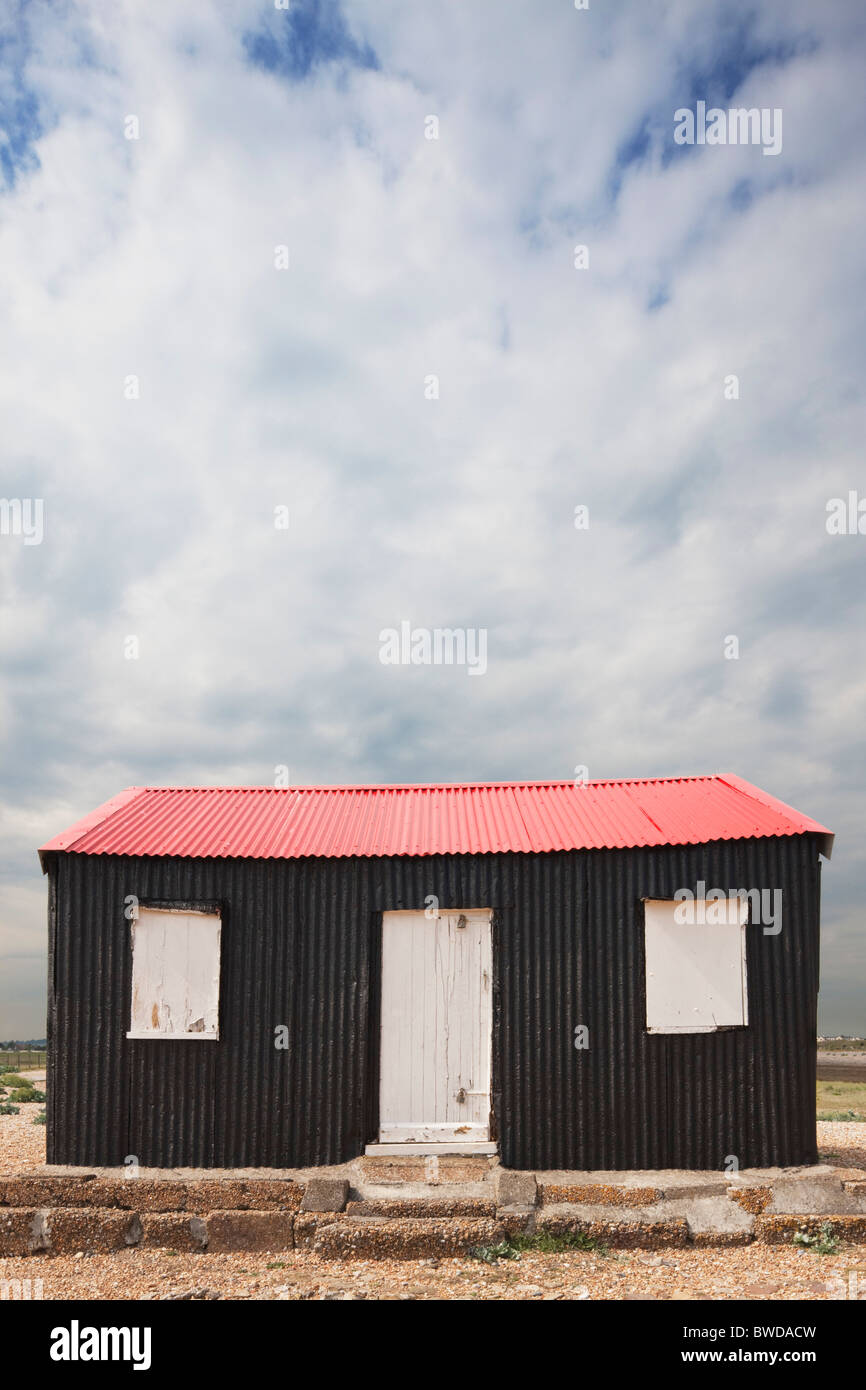 Red roofed fishing hut; Rye Harbour; East Sussex; England, Great Britain - Stock Image